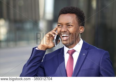 Portrait Of Happy Positive Excited Businessman Talking On His Cell Mobile Phone. Black African Afro