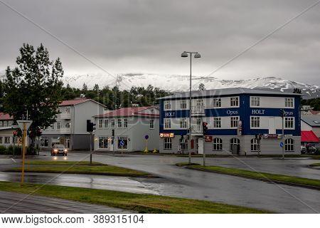 Akureyri, Iceland - July 5, 2014: White-blue Typical Icelandic Building Of Opus Holt With Krua Siam