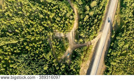 Aerial View Of Country Road With Few Cars Driving Between Forests On A Sunny Day. Scenic Top View Fr