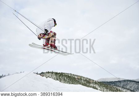 Horizontal Snapshot Of Spectacular Freeriding Fly At The Steep Slopes By Skier. Cool Ski Jump From H