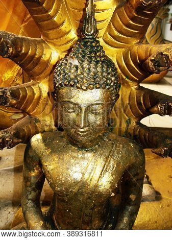 Ayutthaya, Thailand, January 24, 2013: Gold Leaf Covered Buddha Sculpture In One Of The Temples In A