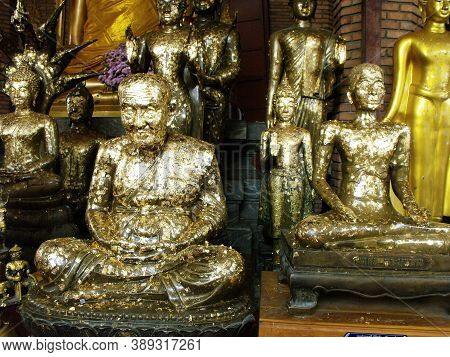 Ayutthaya, Thailand, January 24, 2013: Sculptures Covered With Gold Leaf In A Temple In Ayutthaya, F