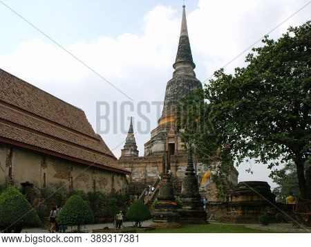 Ayutthaya, Thailand, January 24, 2013: Tourists In A Stupa In Ayutthaya, Former Capital Of The Kingd