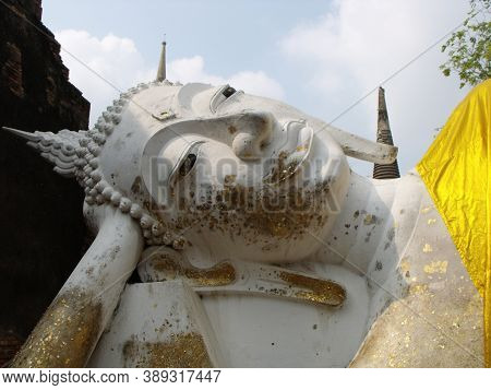 Ayutthaya, Thailand, January 24, 2013: Detail Of Reclining Buddha With Gold Leaf In Ayutthaya, Forme