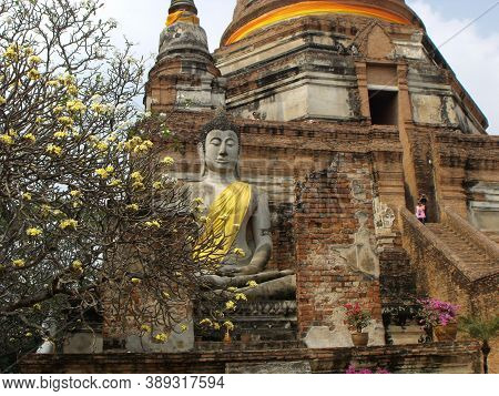 Ayutthaya, Thailand, January 24, 2013: Stone Buddha Under A Stupa In Ayutthaya, Former Capital Of Th