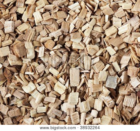 Macro of Hickory wood chips or pellets for hickory smoking.