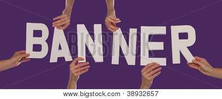 White alphabet lettering spelling BANNER held up over a purple studio background by outstreched female hands