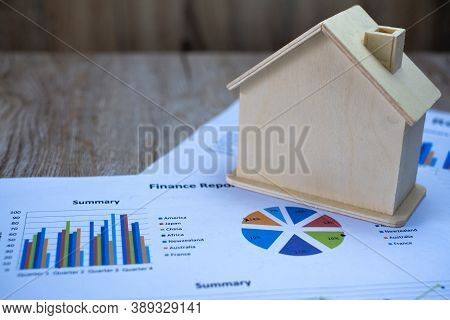 Place Houses On Graphs Or Business Data. Business Growth Ideas, Economic Charts, Real Estate Markets