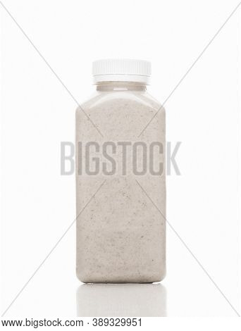 Vegan Almond Milk For Detoxification Against A White Background. Juice Made Of Organic Fruits And Ve