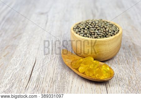 Cannabis Seeds, Wooden Cups And Pills Extracted From Hemp Oil The Concept Of Extracting Hemp Leaves