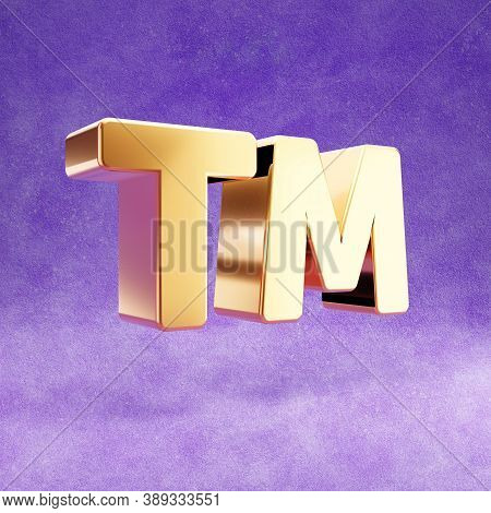 Trademark Icon. Gold Glossy Trademark Symbol Isolated On Violet Velvet Background. Modern Icon For W