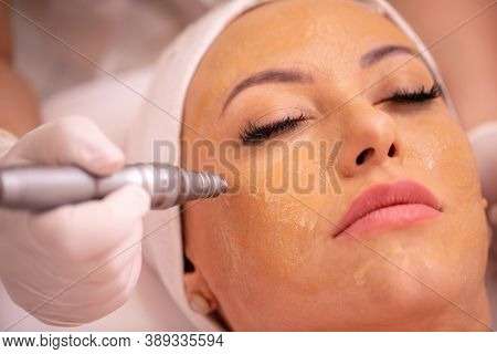 Woman Wearing A Cosmetics Facial Beauty Mask In Close Up