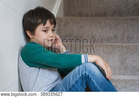 Sad Asian Boy Sitting Alone On Staircase In The Morning, Lonely Kid Looking Dow With Sad Face Not Ha