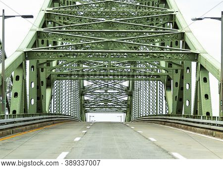 View Of Driving On A Three Lane Highway Up A Bridge Approaching Its Apex With No Cars On The Road Tr