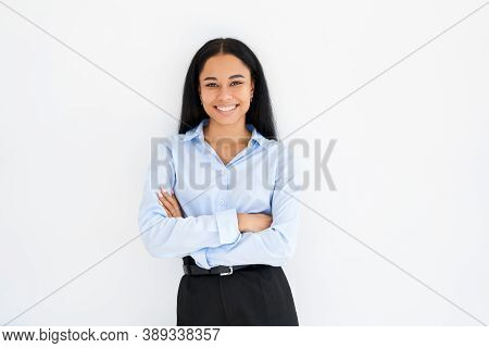Smiling Confident Black Businesswoman With Crossed Arms Posing On White Background. Female Beauty, B