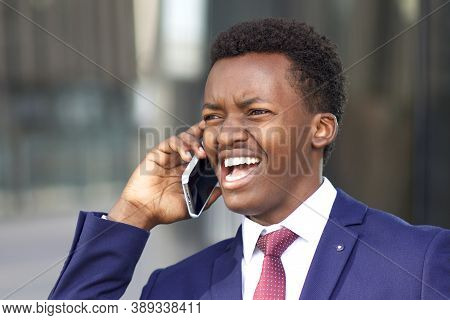 Funny Black African Afro American Annoyed Business Man Calling, Talking On Cell Mobile Phone, Arguin