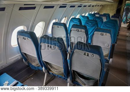 Empty rows of seats on an old plane