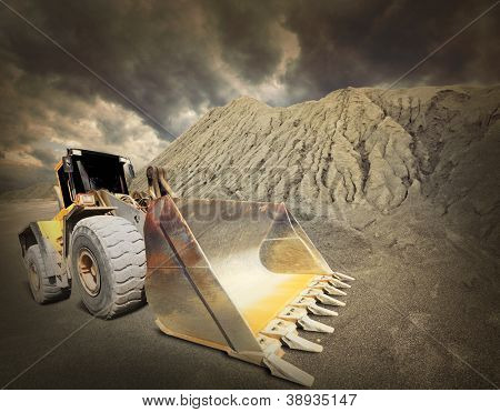 Excavator in the mine. Ecology disaster concept.