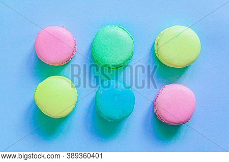 Sweet Almond Colorful Pink Blue Yellow Green Macaron Or Macaroon Dessert Cake Isolated On Trendy Blu