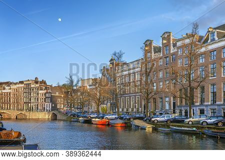 View Of Amsterdam Canal With Historic Houses And Boat, Netherlands