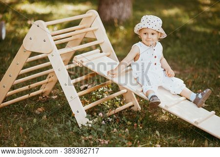 Kid Playing Sport In Childrens Slide On The Sports Complex. 1, 5 Year Old Toddler Baby Climbing Up T