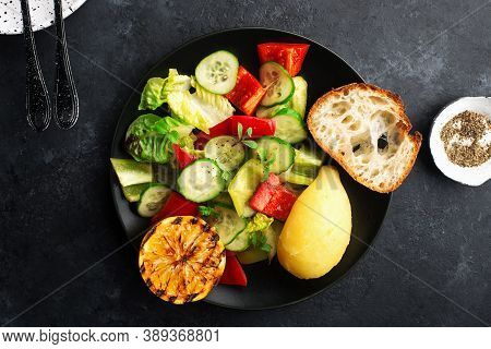 Young Boiled Potatoes, Salad Of Leafy Greens, Cucumber, Capsicum, Micro Greens, Oil, With Lemon On A
