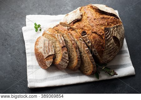 A Loaf Of Fresh Dark Round Buckwheat Bread From A Private Bakery On A Dark Background On A Vintage W