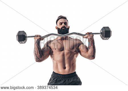Muscular Bodybuilder Guy Doing Exercises With Dumbbell Over White Background.
