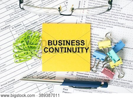 Orange Sticker With Text Business Continuity. Colored Stationery Clips, Green Paper Clips And Eyegla