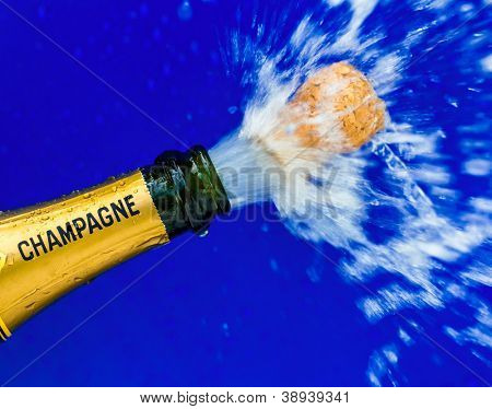 a bottle of champagne is opened. symbol photo celebrate for opening, and year