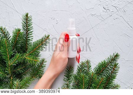 Unbranded White Plastic Spray Bottle, Female Hand With Red Nails And Branches Of Christmas Fir Tree