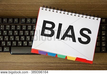 The Word Bias Is Written On A White Piece Of Paper That Is On The Keyboard. The Concept Of Bias Bias