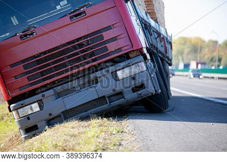 Truck Accident. Lorry Trailer Car Lost Control, Left Interstate Road And Plunges Into Ditch