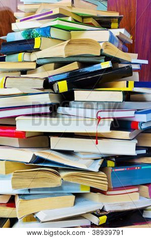 a stack of opened and closed fully books