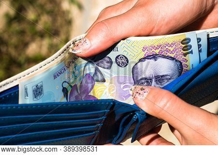 Hands Holding And Showing Wallet With Romanian Money Lei.