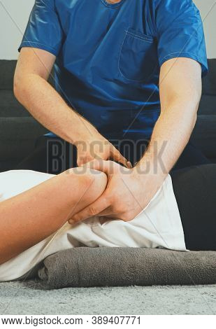 Therapist Massaging Woman's Hands At Her House. Medical Homecare.