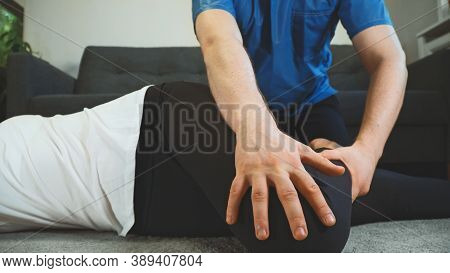 Therapist Helping To Do Back Exercise. Medical Homecare.