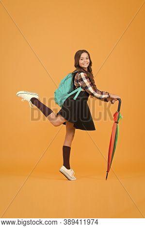 Rain Protection. Happy Small Child With Stick Umbrella Against Rain. Cute Little Schoolgirl Use Umbr