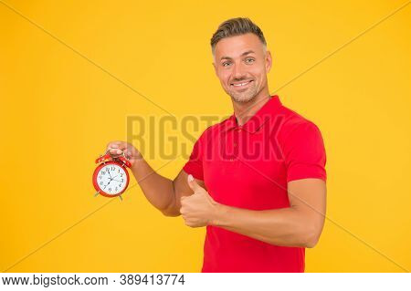 Accuracy And Precision. Happy Man Hold Alarm Clock Showing Thumbs Up. Punctuality And Accurate Timek