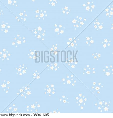 Vector Seamless Pattern With Small White Pretty Flowers On Light Blue Background. Liberty Style Wall