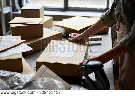 Female Distribution Warehouse Worker Or Seller Packing Ecommerce Shipping Order Box For Dispatching,
