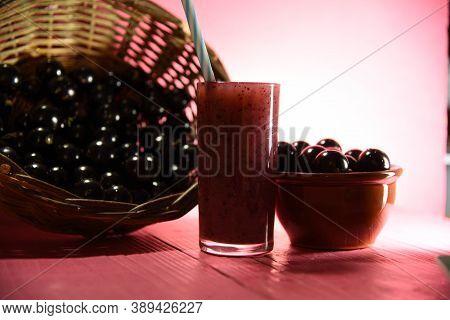 Jabuticaba Juice With Fresh Fruits On Pink Background