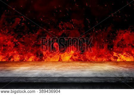Side View Of Empty Concrete Table Top With Orange Fire Or Flame And Sparkles In Dark Room.
