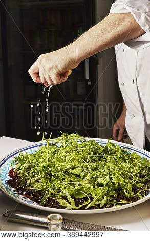 Beet Carpaccio. Chef Pours Lemon On Beetroot Carpaccio With Sauce And Herbs.