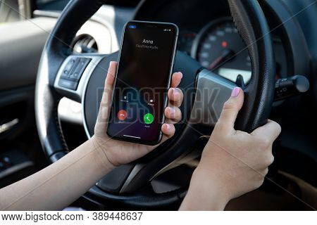Alanya, Turkey - September 23, 2020: Woman Hand Holding Iphone 11 With Widgets Call Phone On The Scr