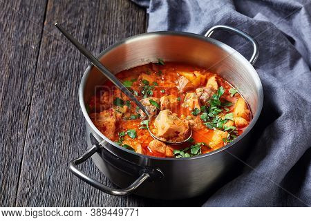 Chicken Arrabbiata Stew With Lentil And Potato In A Pot On A Wooden Table, Horizontal View From Abov