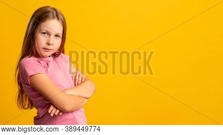 Child Portrait. Disagreement Bullying. Doubt Blame. Confident Skeptic Young Girl In Pink With Folded