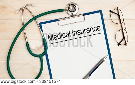 Medical Insurance With Insurance Claim Form And Stethoscope. Medical Insurance Concept