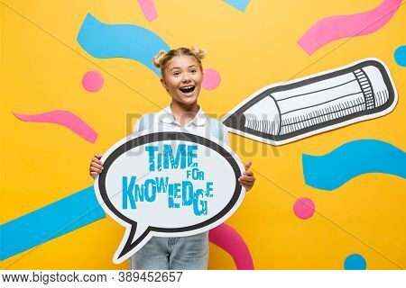 Schoolchild Holding Speech Bubble With Time For Knowledge Lettering Near Multicolored Paper Elements