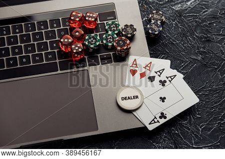 Chips, Dices And Playing Cards With Aces For Poker Online Or Casino Gambling. Online Casino Concept